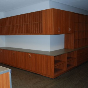 Modular Casework installation with wall mounted cabinets and base cabinets